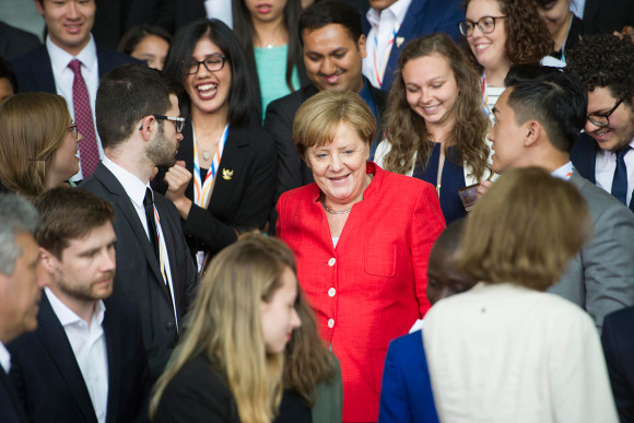 Chancellor Angela Merkel and participants at the Y20 summit gather for a group photo at the Federal Chancellery.