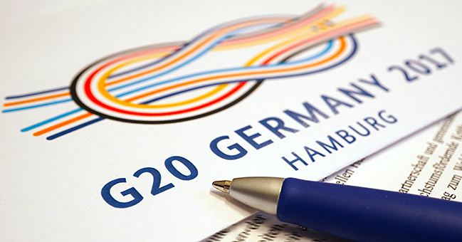 View of documents with the logo of the German G20 presidency